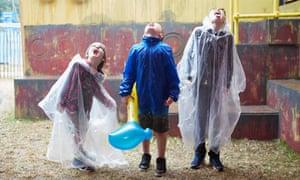 Kids catching rain at Glastonbury