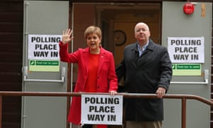 Nicola Sturgeon, Scotland's first minister, and her husband, the SNP chief executive Peter Murrell, leaving a polling station at Broomhouse Park Community Hall in Glasgow after casting their votes