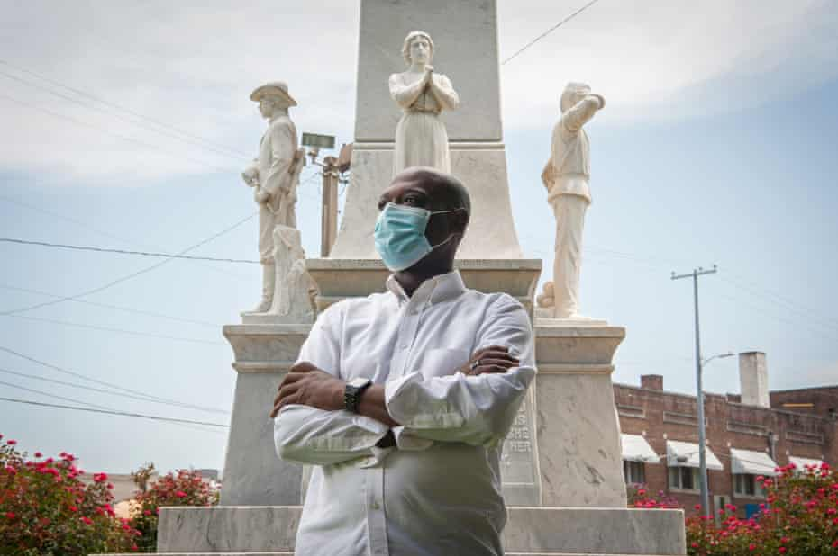 Local activist Tavaris Cross poses for a portrait at the Confederate monument outside the Leflore County Courthouse in Greenwood, Mississippi, on July 15, 2020. Photo by Rory Doyle for The Guardian.