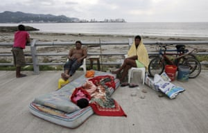 A family rests along Bahia de Caraquez