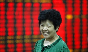 Investor looks at boards in Shanghai Composite Index.