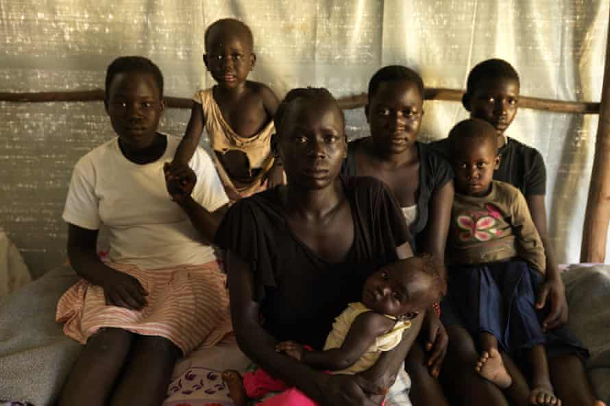 Gloria Keoji, 23, centre, holding her three-month-old son, with, from left to right, Zubeida Flores, Keoji's two-year-old daughter, Margaret and Betty Tomalu, who holds Sharon on her lap.