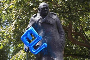 A blue EU balloon is tied to the statue of Winston Churchill in Parliament Square