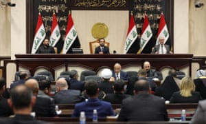 People sitting in the Iraqi parliament