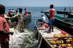 Local fishermen prepare their nets