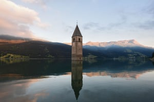The bell tower of Curon's old church and village were submerged in 1950 in an artificial lake created to power a hydroelectric plant