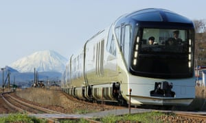 The train passes through Date, Hokkaido, with Mount Yotei in the background
