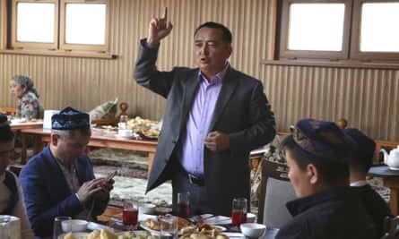 Serikzhan Bilash speaks to a crowd of Kazakhs at a restaurant in Almaty