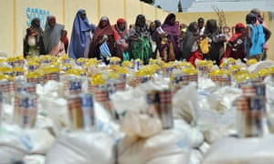 Displaced Somali women queuing for food-aid rations at a distribution centre during a visit to assess the progress of relief efforts by UN Office for the Coordination of Humanitarian Affairs [OCHA] in Mogadishu in 2012