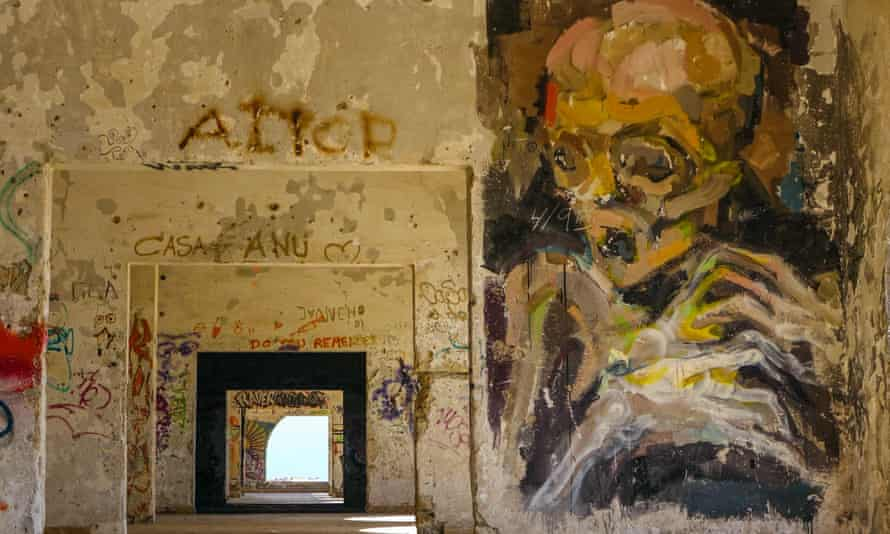 Deserted, abandoned building with big drawing of scared looking skeleton