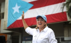 Mayor Carmen Yulín Cruz speaks to the media as she arrives at the temporary staging ground for relief efforts at the Roberto Clemente stadium in San Juan.