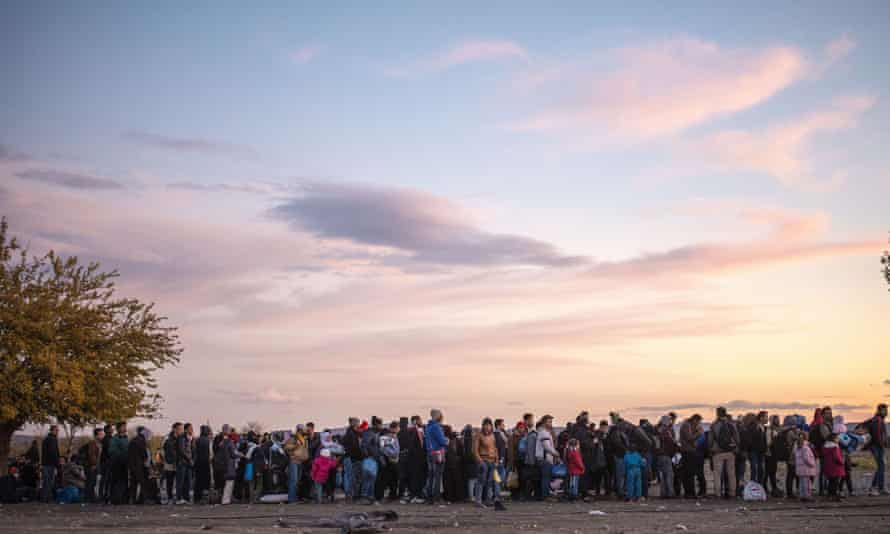 People queue at a registration centre after crossing the border between Greece and Macedonia.