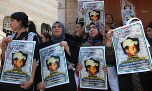 Relatives of Mohammed Abu Khdeir hold his picture during a protest in July last year