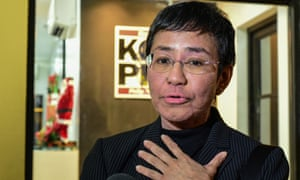 Maria Ressa, co-founder and CEO of the Philippines-based news website Rappler, speaking to members of the media as she leaves after a hearing in a court in Manila in December 2019.