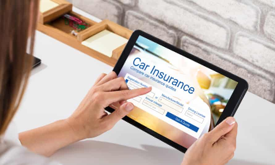 A woman ponders car insurance on a tablet.
