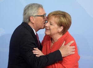 Merkel welcomes the president of the European commission, Jean-Claude Juncker.