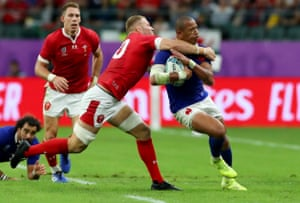 Wales' Ross Moriarty tackles Gael Fickou of France and receives a yellow card.
