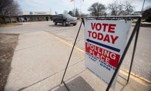 A truck leaves a polling place in Warren, Michigan