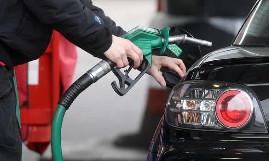a motorist fills his tank