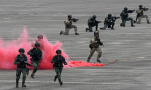 Taiwan soldiers take part in drills on Thursday that simulate an attack by China.