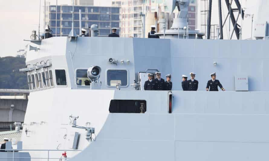 Sailors on board one of the three Chinese naval ships that arrived at Garden Island Naval Base in Sydney on Monday