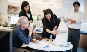 Architects discuss building design.