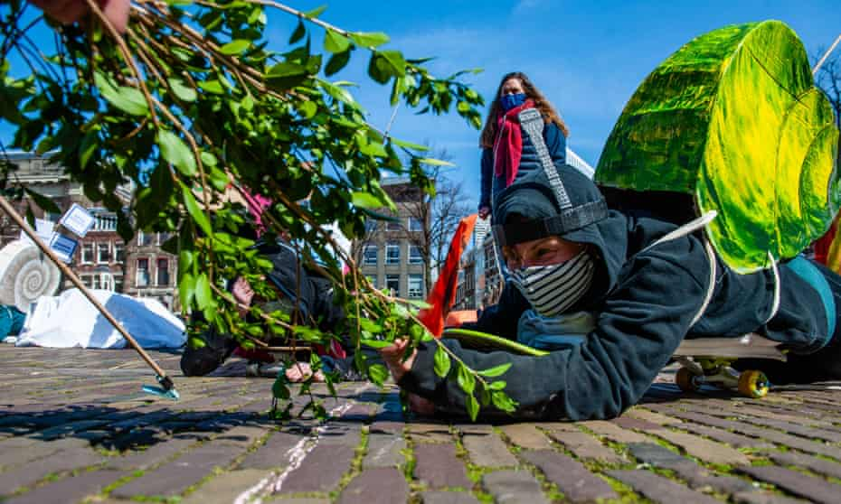 XR activists dressed as snails protest against the slow movement towards net-zero emissions in The Hague, Netherlands, on 3 April 2021.