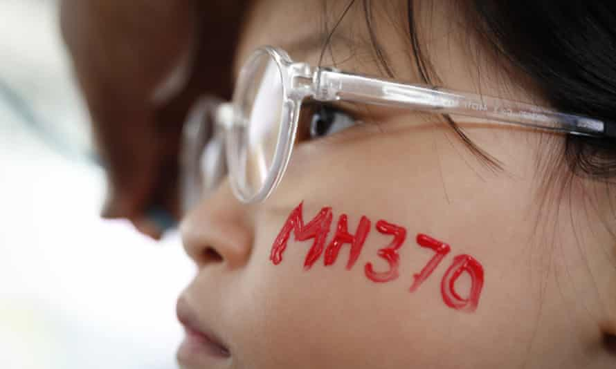 In this photo taken March 3, 2018, a girl has her face painted during the Day of Remembrance for MH370 event in Kuala Lumpur, Malaysia.
