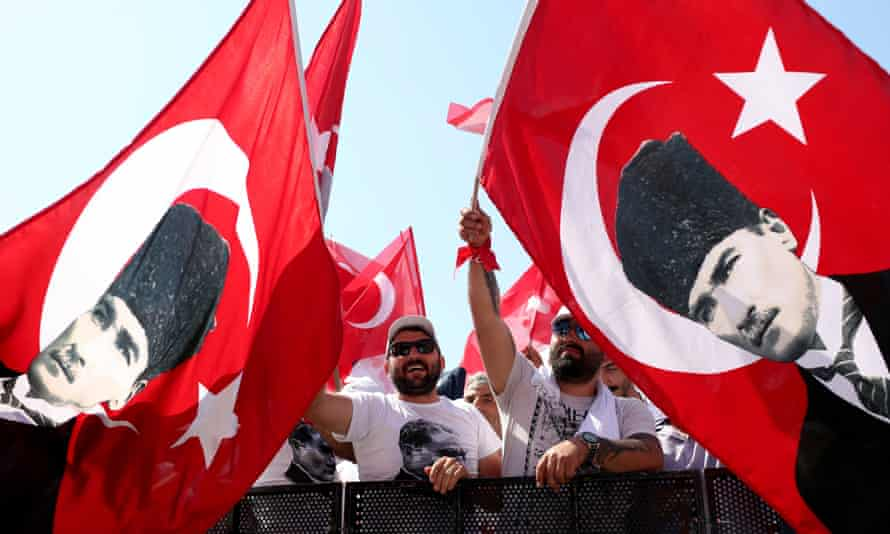 Supporters of the Republican People's Party (CHP) wave flags carrying the portrait of Mustafa Kemal Ataturk, who is regarded the founder of modern Turkey.