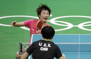 Ding Ning, of China, top, v Li Xiaoxia, of China.