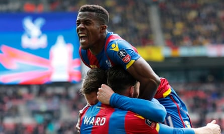 Wilfried Zaha celebrates with his team-mates after Connor Wickham scored Crystal Palace's second goal in the FA Cup semi-final against Watford