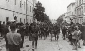 A crowd welcomes a column of German soldiers in a Lvov street in 1941.