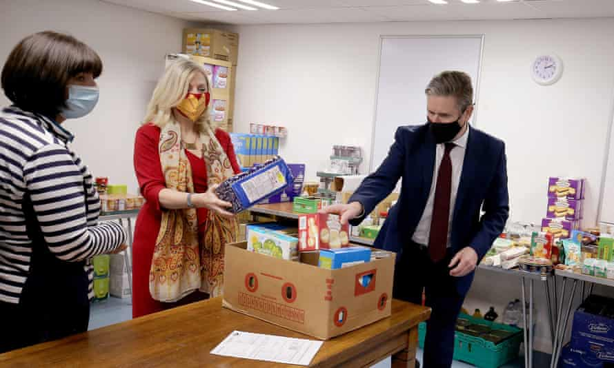 Packing food parcels with party leader, Keir Starmer, during a visit to Wakefield, 2020.