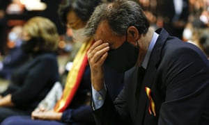 A person reacts as people attend a tribute to the victims of the Covid-19 in the cathedral of Seville.