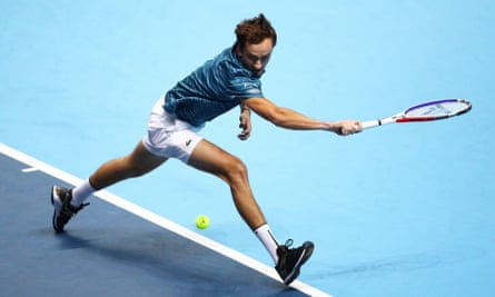Daniil Medvedev stretches to play a backhand against Stefanos Tsitsipas.