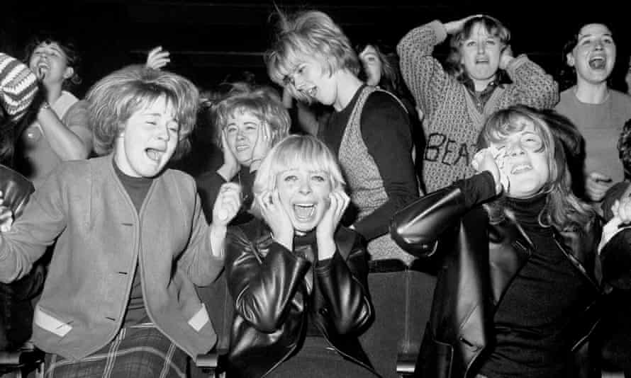 Screaming women fans of the pop group The Beatles at one of their concerts in Manchester in 1963.