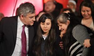 Gordon Brown hugs 14-year-old Thiara Sanchez after her plea at Central Methodist Hall.