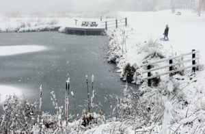 A young sledger look at ice covering the Caen Hill Locks on the Kennet and Avon Canal, near Devizes, in Wiltshire