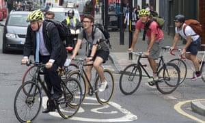 London mayor Boris Johnson with a group of cyclists on suburban road
