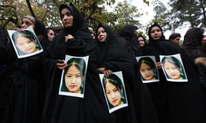 Afghans protest against the killing of civilians from the Hazara minority by suspected Islamic State militants during a protest in Herat, on 12 November.