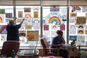 The nurses' office space in the ID ward is decorated with rainbows of hope from well-wishers