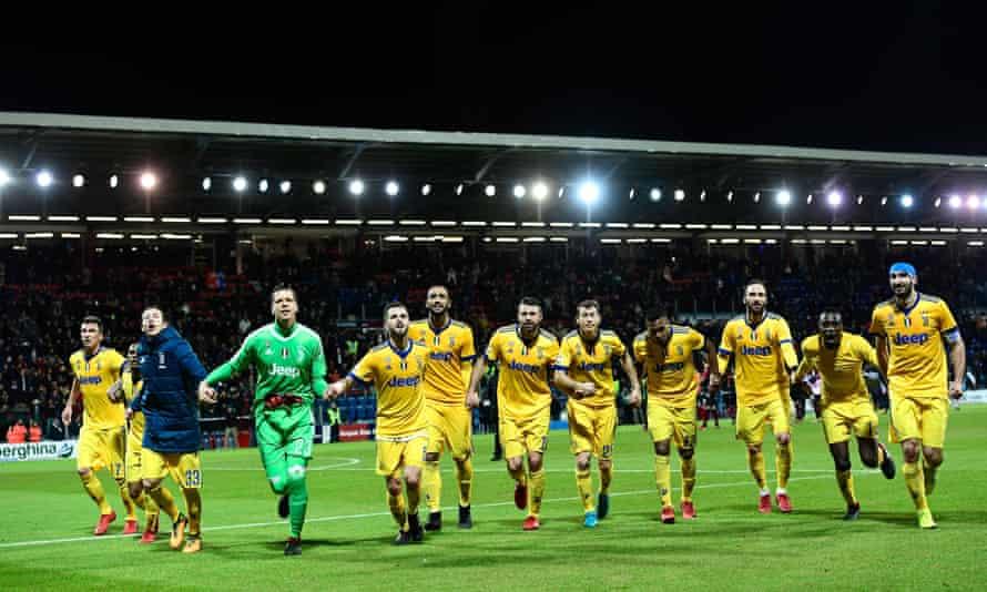 Juventus players celebrate after beating Cagliari at the Sardegna Arena.