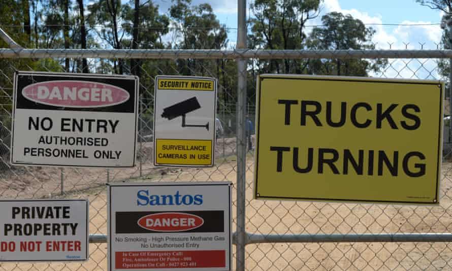 Signs on cyclone wire fencing of Santos' Narrabri gas project