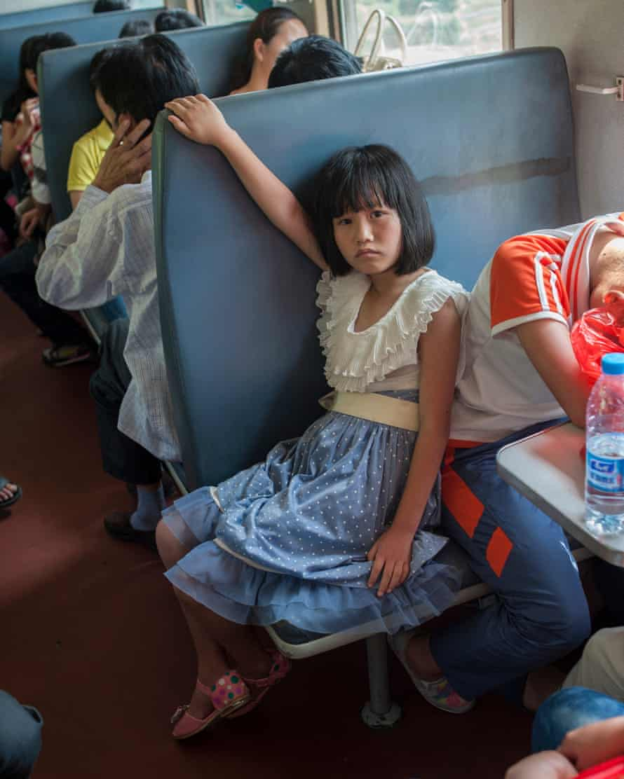 A young girl is captured in an image from The Green Train
