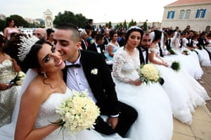 Bkerke, LebanonA groom kisses his bride as Lebanese Maronite Christian couples take part in a mass wedding at the Maronite Patriarchate in Bkerke. Fourty one couples got married during the event organised by the Maronite league.