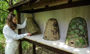 "The 'Zlota Galaz' beekeeping facility at work in Nowy Gaj, Poland, has some nice examples of traditional up-right mud ""skeps"" that have been used for beehives since the middle ages."