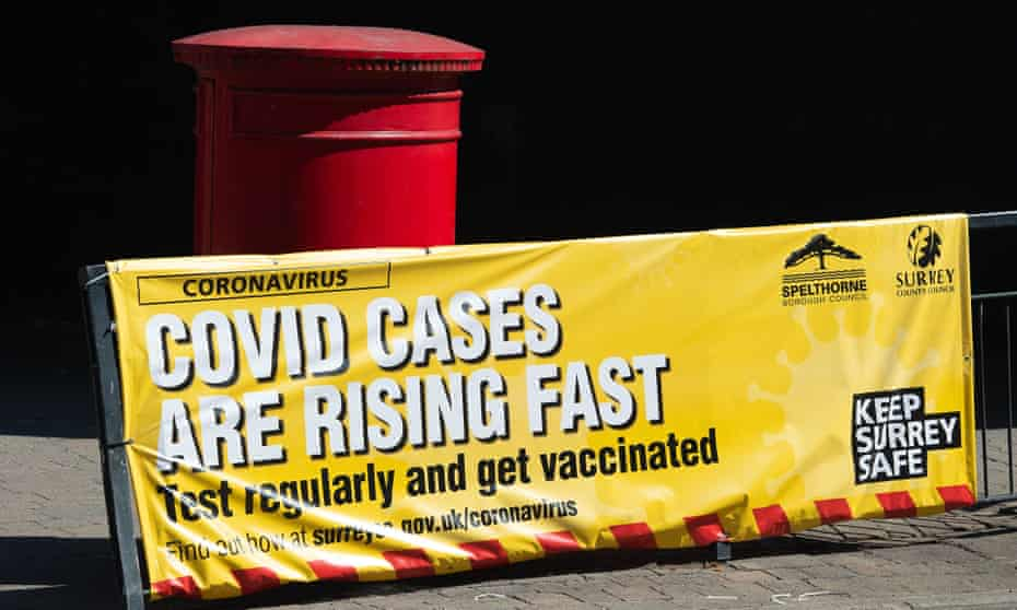 A sign  in Staines town centre warning shoppers that Covid-19 cases are rising fast and for them to get tested regularly and get vaccinated