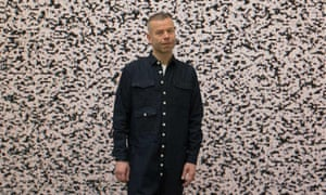 Wolfgang Tillmans with his work Sendeschluss/End of Broadcast V, 2014 at Tate Modern.