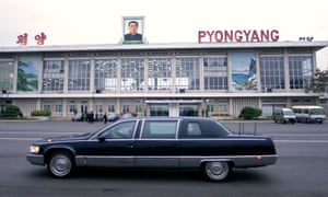 Pyongyang, 2000: A limousine carrying the then US secretary of state Madeleine Albright passes a portrait of Kim Il-sung during her historic trip to North Korea.