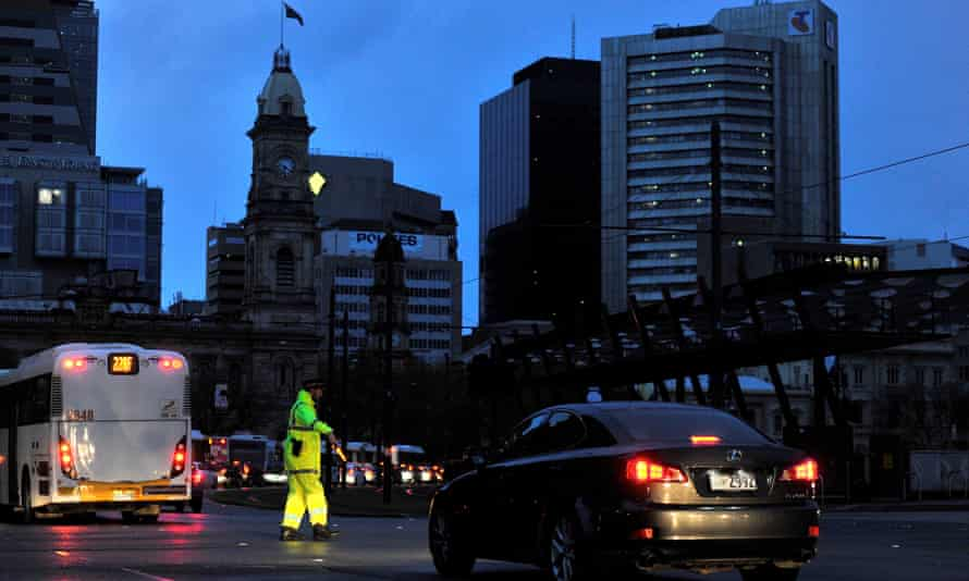 Police direct traffic in the central business district of Adelaide after blackouts